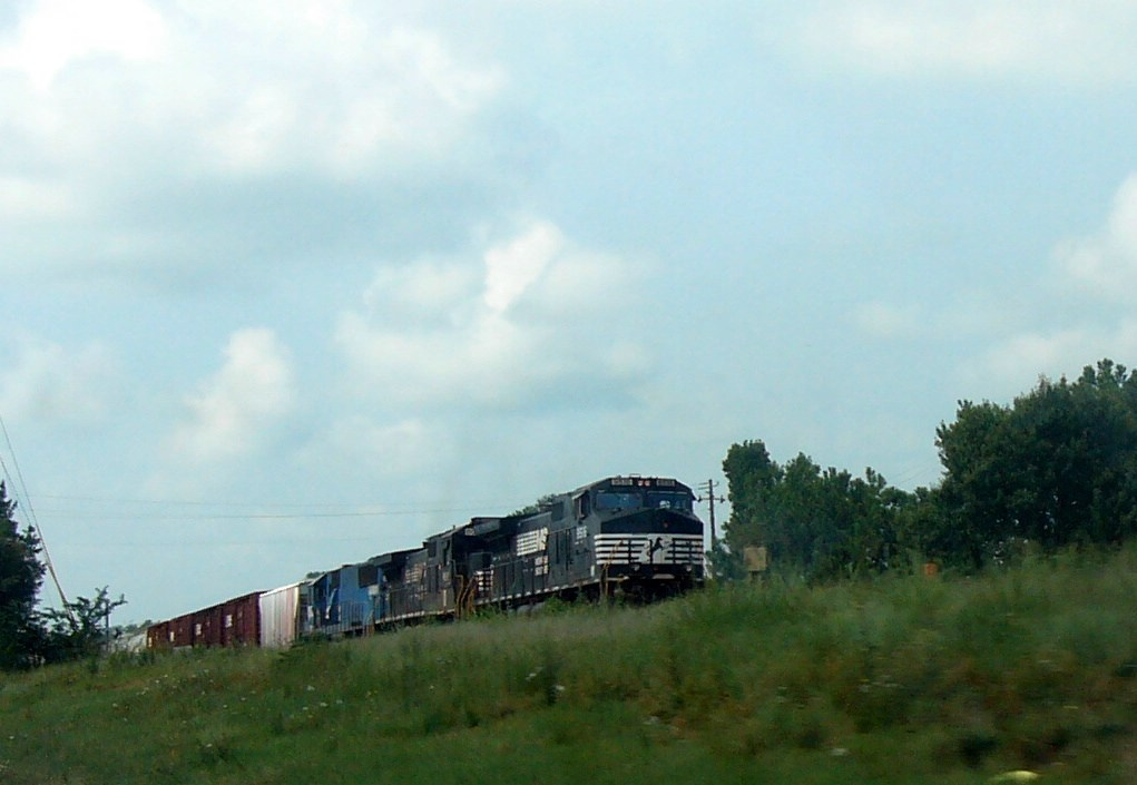 a Northbound Manifest with an NS GE CW40-9,an NS GE C40-9 and a NREX (National Railway Equipment) ex NS/Conrail Patched GM/EMD SD50 Idles at the Grade Crossing at the North End of/Exit to the NS Yard