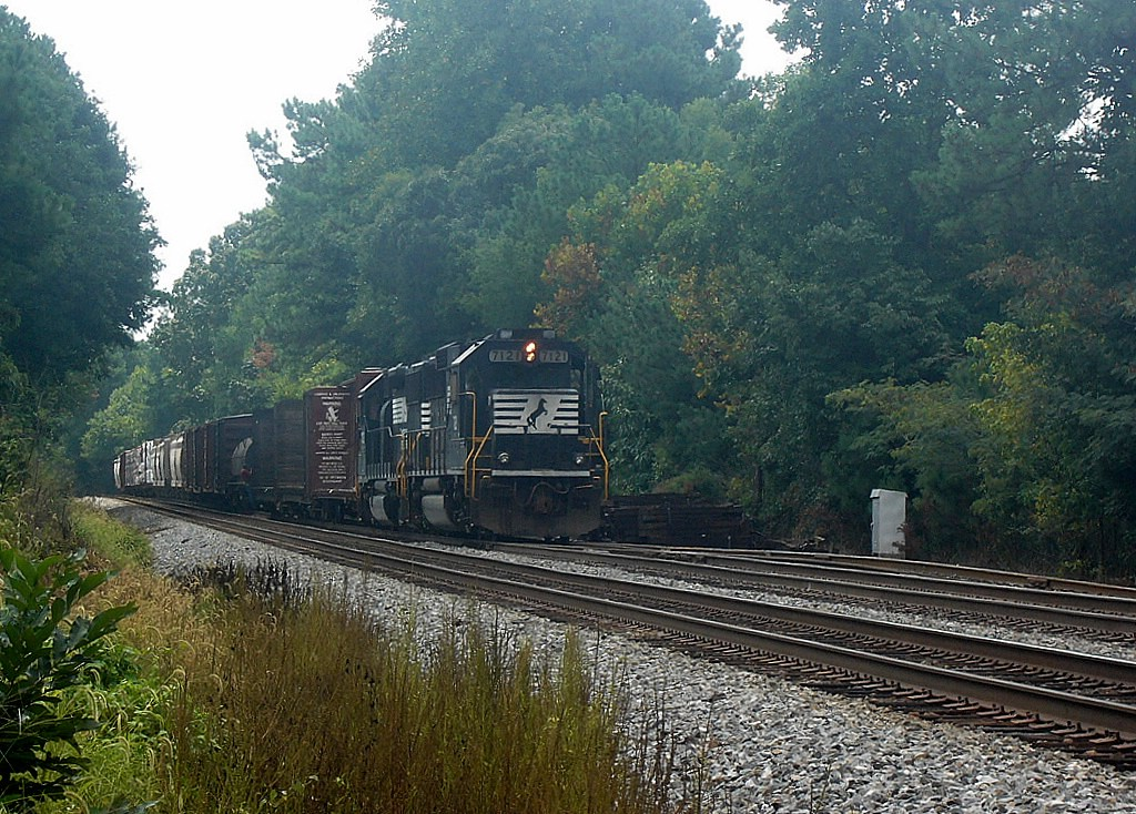 Power for NS's Duluth Local,NS GM/EMD GP60 7121 and an NS GM/EMD GP50 Idle Near the Main Street Grade Crossing