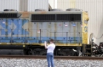 Power for CSX's Chatsworth Local, a GM/EMD GP40-2 in CSX's YN2 paint and a GM/EMD GP35 Road Slug in CSX's YN2 paint wait for some work
