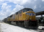 a UP Wings GM/EMD SD70M and 2 CSX GE CW44ACs Idle at CSXs Hulsey Intermodal Yard