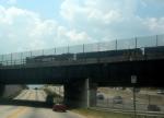 NS GM/EMD GP38-2 5153 Idles in the Yard on the I75-85 Bridge