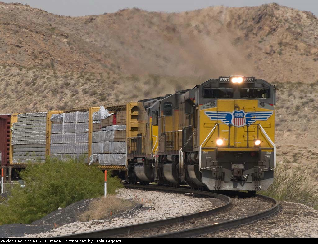 UP 8352 leads an EB manifest QWCFW? (West Colton - Ft Worth) at 11:10am