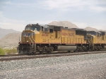 UP 4434 leads a WB doublestack at 1:05pm