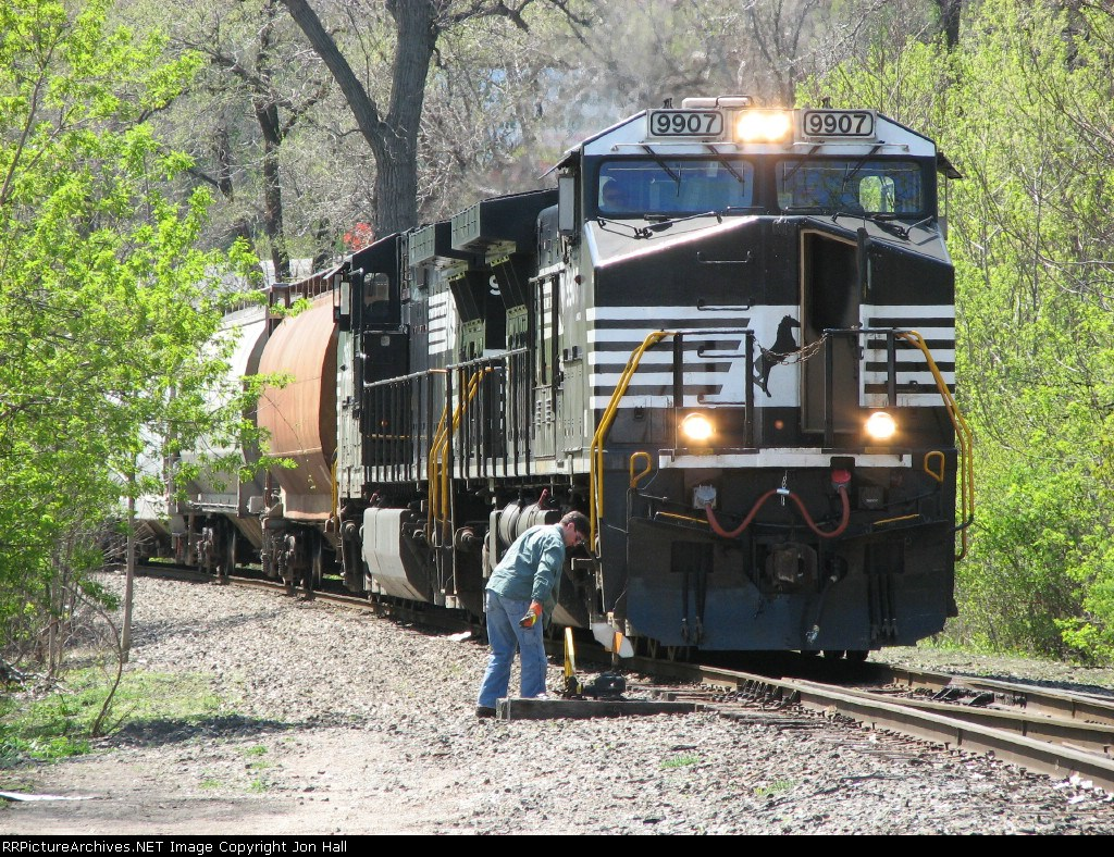 The conductor checks the switch after lining it for the mainline before 36E proceeds into the yard