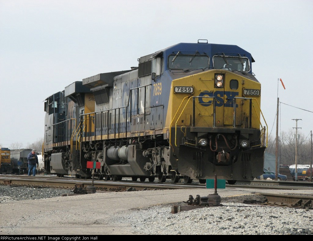 CSX 7859 & 5464 wait to back up as the conductor checks the switch behind them