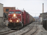 CP 8615 works its way up the grade out of town with the 6300 feet of X500-02 behind it