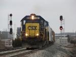 CSX 8586 leads Q326-09 eastward through the west end signals