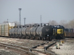 CSX 8395 hides behind a cut of tanks and autoracks waiting to head east with Q326