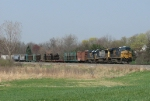 5222 leads Q326-23 east with three loads of utility poles near the headend