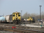 1177 & 1139, both of the yards two MP15AC's, go about their work at the east end