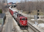 SOO 6042 leads X500 under US-131 and past the Pleasant Street signals