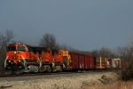 BNSF C44-9Ws 1026, 4857, and 4034 lead a westbound manifest.