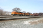 BNSF 7584 leads a loaded coal train to the steel mills