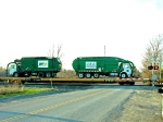 garbage trucks on a train