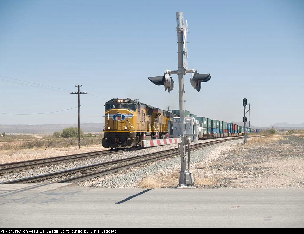 UP 4907 leads a WB doublestack at 1:47pm