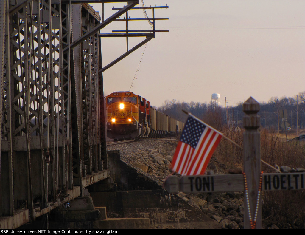 BNSF 8918 passes bye with old glory flying.