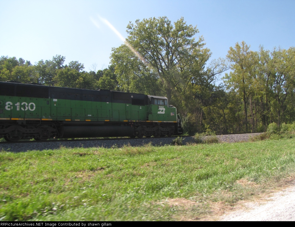 BNSF 8130 leads a rock train north nice to see this again,