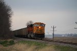 BNSF 9874 leads a coal load south.