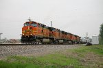 BNSF 4561 takes the siding to meet 2 southbounds at old monroe,