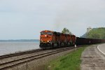 BNSF 5822 leads a empty ore along the Mississippi river.