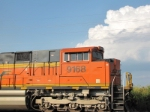 BNSF 9168 with storms off in the distant