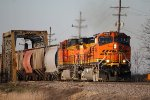 BNSF 4484 leads this grain train sb at elsberry with a new paint job.