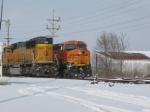 BNSF 6296 holds the siding as 9942 brings up dpu.