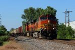 BNSF 4974 is on the point of a loaded grain train.