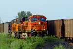 BNSF 5886 leads a loaded coal sb past a empty in the siding.