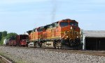 BNSF 5465 leads a freight train out of the siding.
