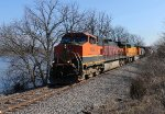 BNSF 1054 leads a memgal nb along the river,