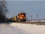BNSF 5854 leads a machens load of coal south,