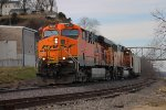 BNSF 5821 leads a wb coal train down river front.