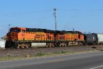 BNSF 6037 lead the local nb out of old monroe mo.