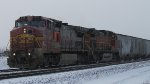 BNSF 949 leads the memgal into the siding for a meet in the snow.