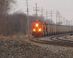BNSF 5769 swings the curve with a load of coal.