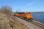BNSF 5976 leads a coal load next to the mississippi