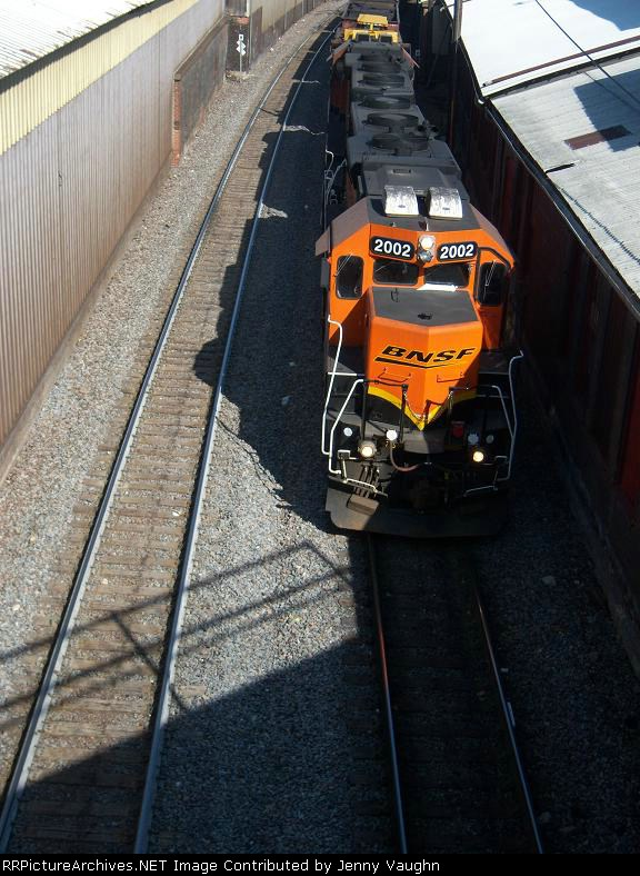 BNSF 2002 and BNSF 2009 rumbling under me with a loaded east bound tie train.