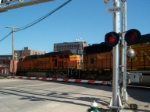 BNSF 8870 and BNSF 6115 going through the crossing
