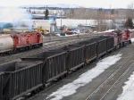 Cp coal emptimes with a pair of geeps switching out a cut of cars