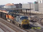 CSX 354 leads CSX freight past AMTRAK station