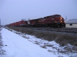 CP 9735 leads a eastbound Intermodel in morning flurries