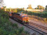 BNSF 7512 heads wb with a stack train in tow.