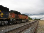 BNSF 5111 leads this wb stack train down main 2 into a storm.