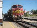 BNSF 613 leads a wb corn syrup train.