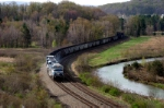 An empty coal train meanders along the Conemaugh River east of Johnstown