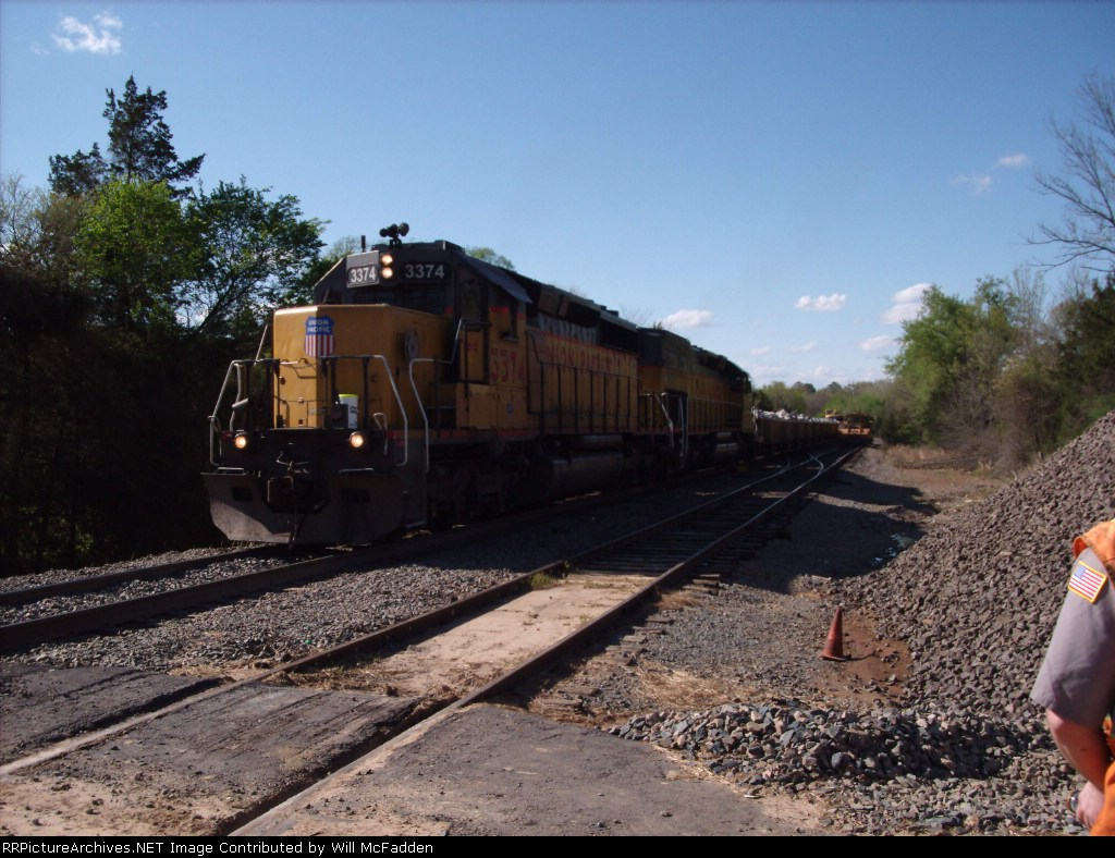 UP 3374 with a rip rap train
