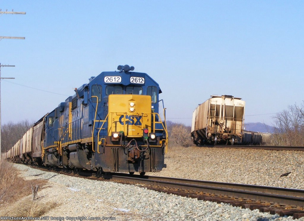 H776 brings a second cut of grain up the nearly 2% grade of the connection at JD cabin
