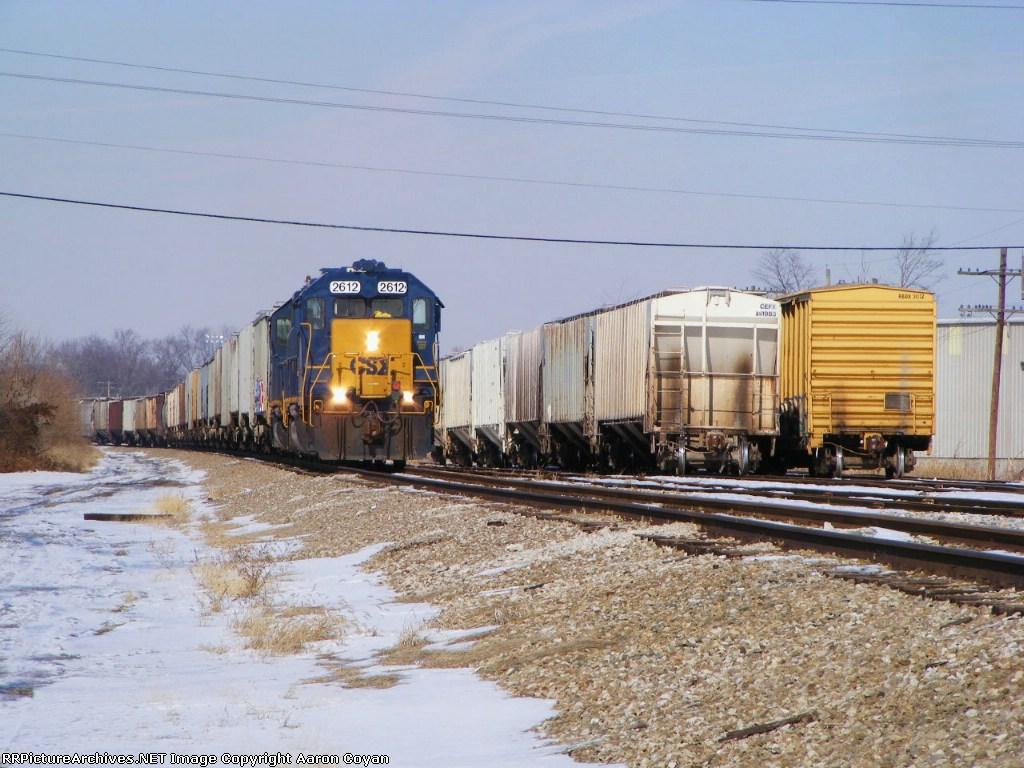 H776 with a 69-car grain train in Renick yard
