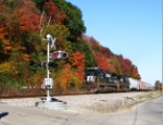 NS EB freight 186 passing colorful trees at MP 651
